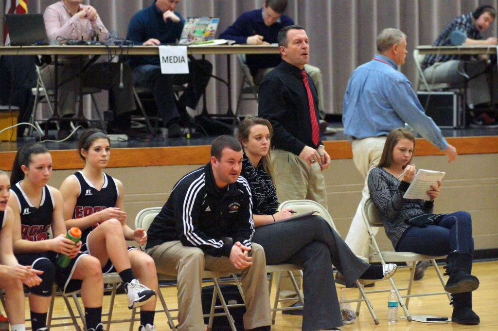 LADY EAGLE COACHES LEAD AT MOBERLY-Knox County took fifth ranked New Franklin to the wall in a 60-58 overtime loss at the March 8, 2014 Moberly Class 2 Girls Quarterfinal. Shown from left to right for Knox County are: Madison McCabe, Karissa Hamlin, Assistant coaches Zach Summers and Randi Summers, Head Coach Keith Gudehus along with statistician Jill Strange. Photo by David Sharp