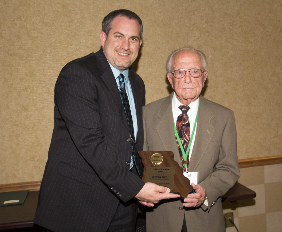 Lewis Co. REC Mangner of Member Services Travis Mathes had the honor of presenting Burrell Smith his award, inductingSmith into the Missouri Institute of Cooperatives Hall of Fame.
