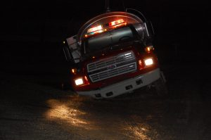 One responding tanker sunk in at the edge of the road.