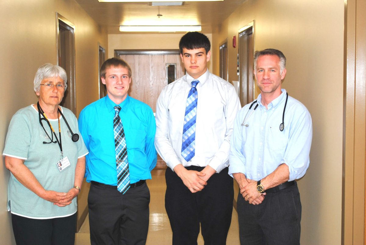 STUDENTS SHADOW MEDICAL PROS--CCR-1 Students Cody Kice and Logan Doty shadowed two health providers at Memphis Medical Services. Left to Right - Marilyn Day, Logan Doty, Cody Kice & Dr. Matt Cormier.