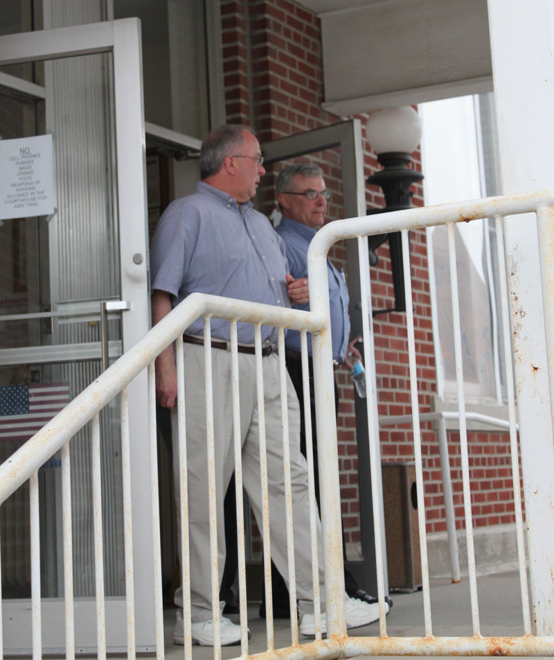 Glenn Head, right, and a friend leave the Randolph County Courthouse in Moberly, Mo., after the first day of his second-degree murder trial. Head was charged in the Dec. 11, 2012, shooting death of William Bacon near Novelty in rural Knox County. (H-W Photo/Don O'Brien)