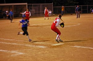 Senior Kailey Roberts tags first and fires the ball home.