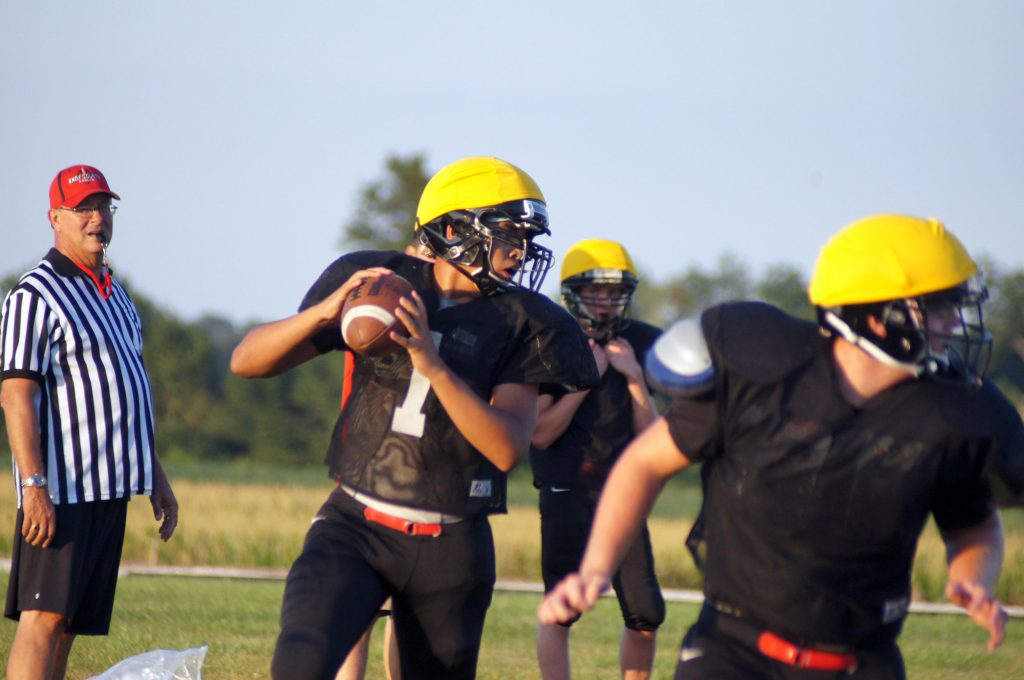 Cedric Boone looks for an open receiver during the August 17, 2013 KC Football Scrimmage