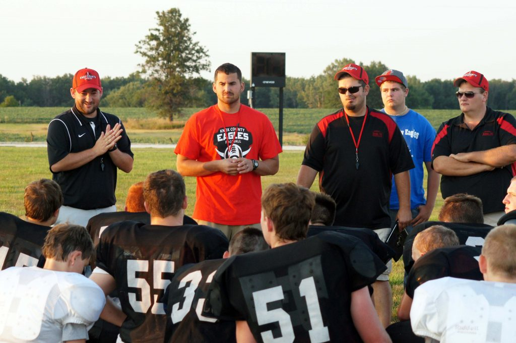 Eagle coaches talk to players after 2013 Public Football Scrimmage