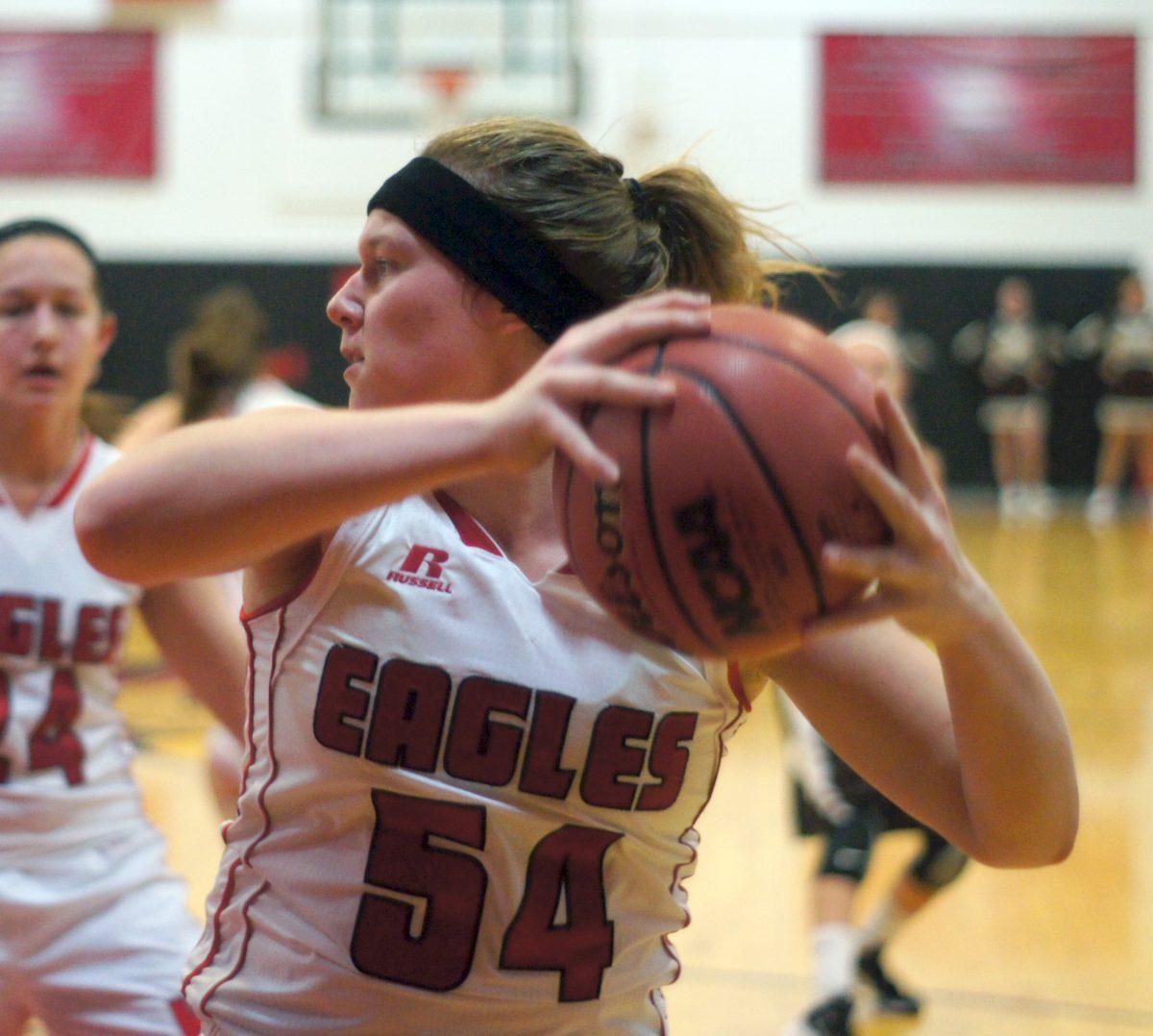 Sarah Dooley pulling down a rebound at Highland.