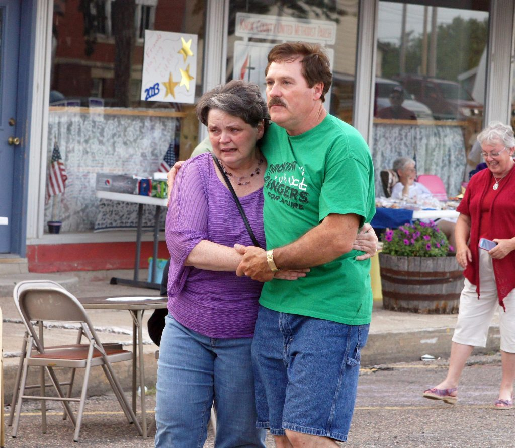 Julie (Bishop) Smith and David Hamlin walk in the Caregiver Lap of the 2013 Knox County Relay For Life. Julie lost her father Jack Bishop to cancer.