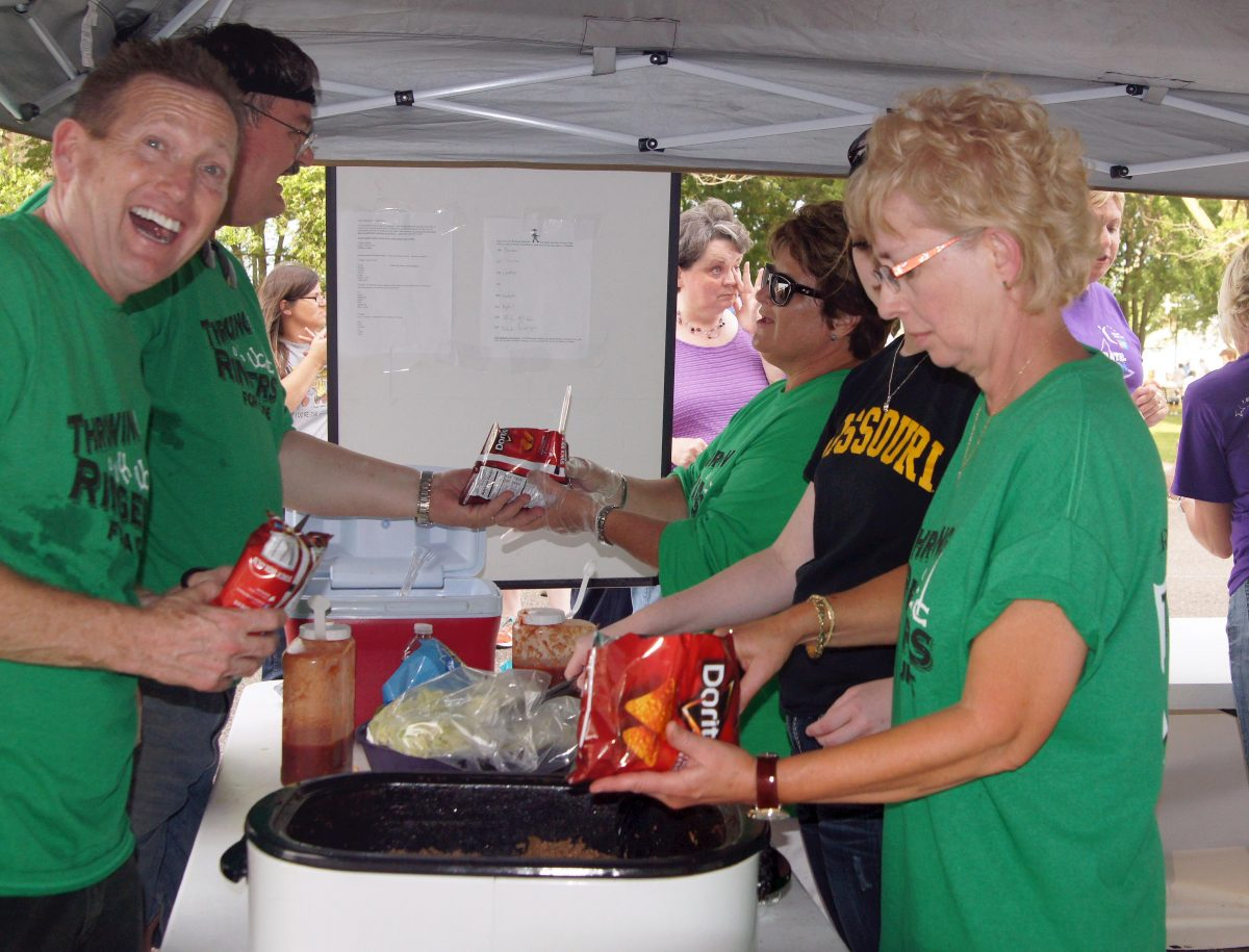 The Throwing Ringers For A Cure 2013 KC Relay For Life Team prepares Walking Tacos for a few hundred participants.