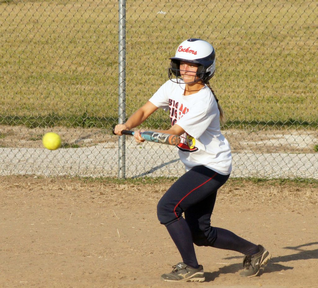 Paige Couch hones her bunting skills at a Lady Eagle softball pre season practice.