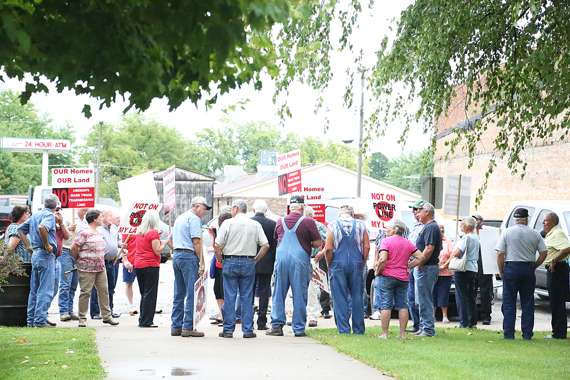 Opponents of Ameren's Mark Twain Transmission Line project gathered inside and outside the Shelby County Courthouse Thursday morning, as Ameren officials met with area county commissioners.