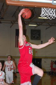 Chase Bevans makes an aggressive move to the hoop against Macon,
