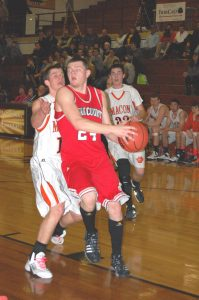 Chase Bevans drives and passes off the ball.