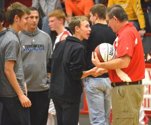 Coach Jon Kirchner is retiring from coaching after 35 years. On Tuesday, December 10, Kirchner was honored during the Middle School basketball game, receiving a game ball and being honored by current and former players. Photos by Teri Hooper.