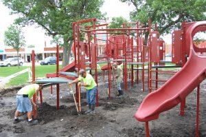 Kahoka workers install the new playground equipment.