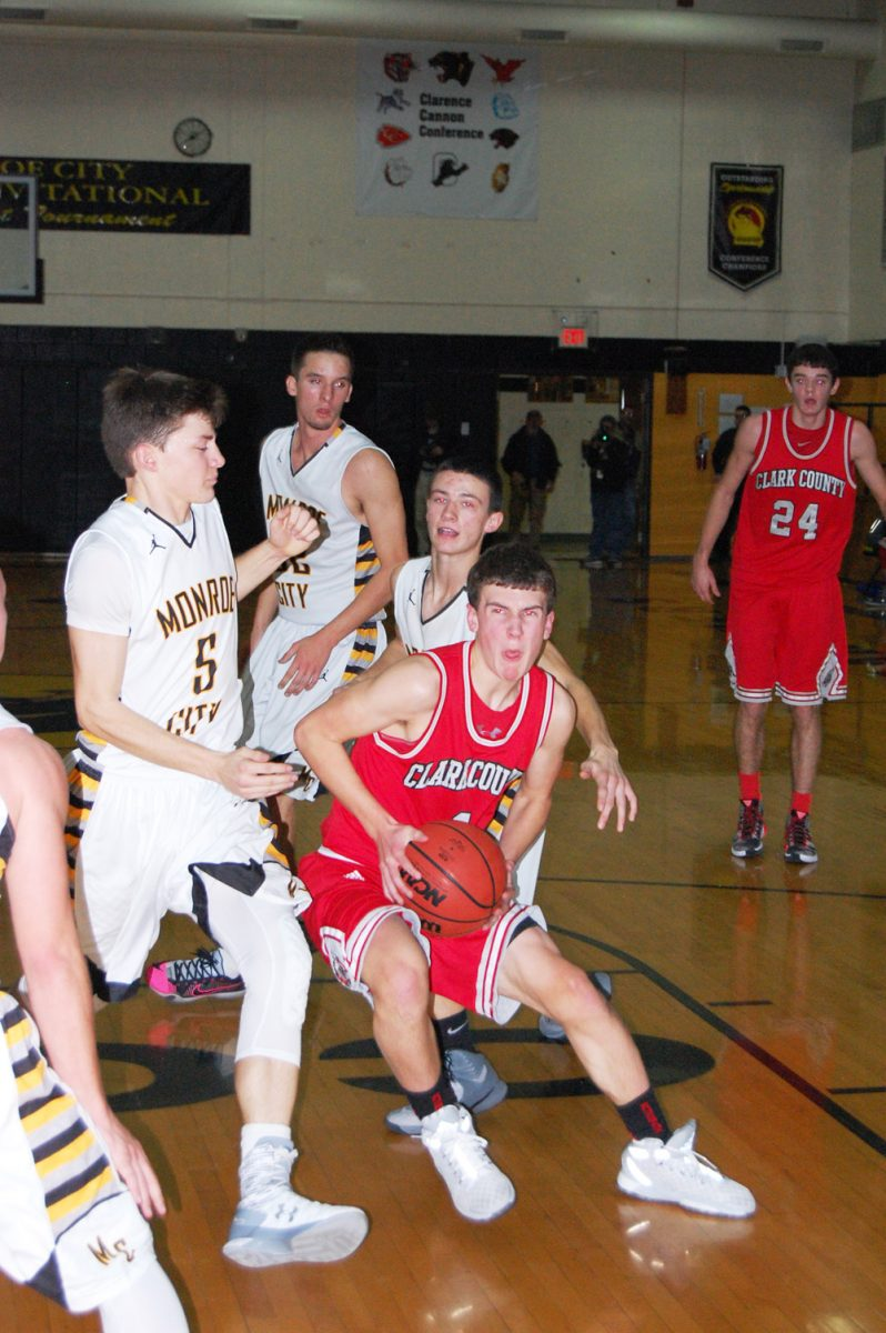 Zeb Riney makes a strong move the basket at Monroe City. Riney had 16 points in the contest.