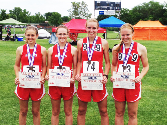 "Lady Indians Medal at State Track Meet-The Clark County Lady Indians medalled in the 4x800 relay race at the Class 3 State Track Meet, held Friday and Saturday in Jefferson City. The team of Drenda Hess, Keelie O'Brien, Renae Buschling and Rachel Buschling finished seventh, with a time of 10:14.03. Jessica Roberts finished seventh in the discus, with a throw of 104' 10"". Renae Buschling placed ninth in both 1600M and 3200M runs. Photo courtesy of Jason Harper."