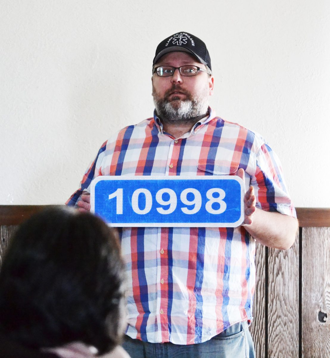 Clark County Ambulance Director Mike Koenig shows one of the five-digit 911 address signs that will be installed for both rural and in-town addresses in Clark County, beginning later this year.