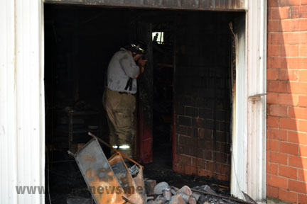 Fire Marshal investigates the fire at Ott;s