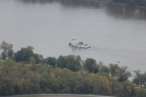 A barge assists in the search for a missing person in the Mississippi River near Gregory Landing.