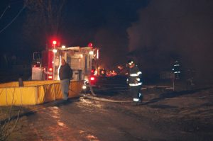 Crews pump water while waiting for another tanker.