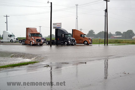 Flood waters surround truck at Ball Volvo