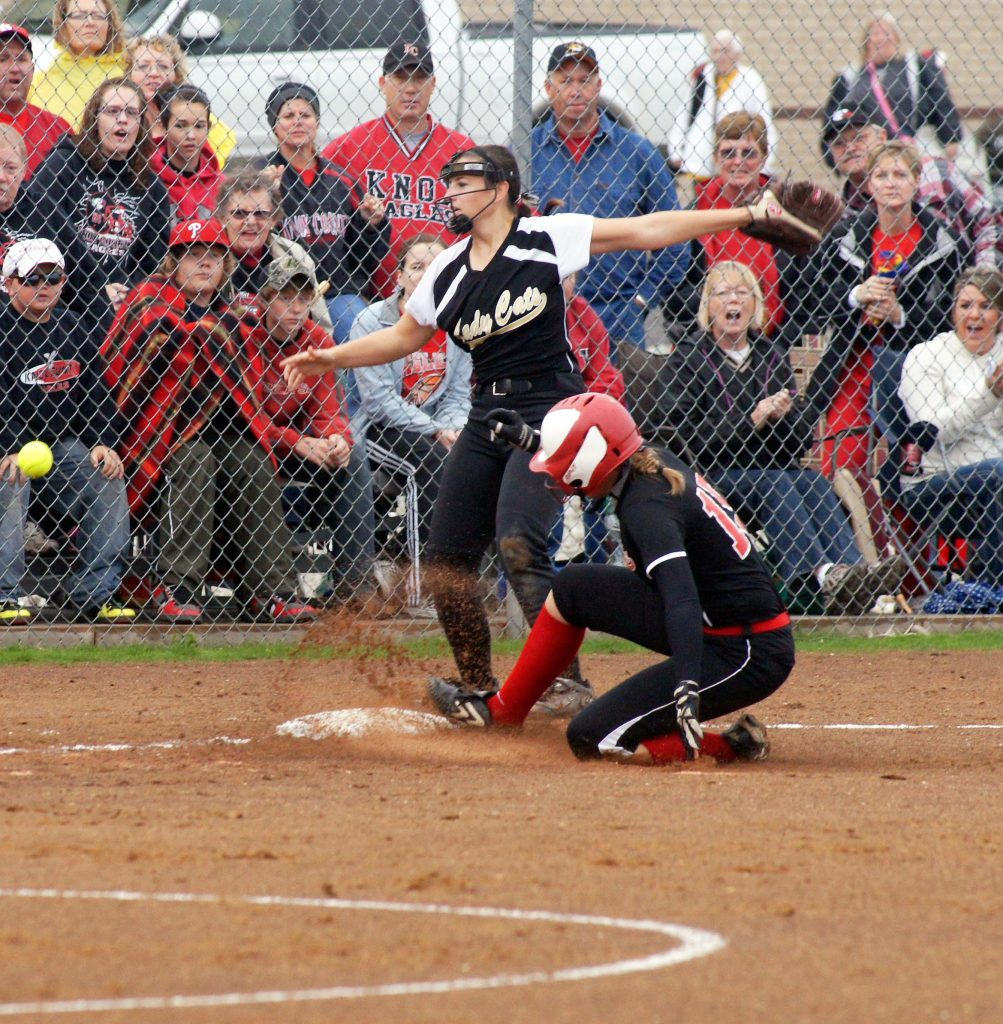 Lauren Dale slides into third base during 2012 softball quarterfinal play with Cairo.