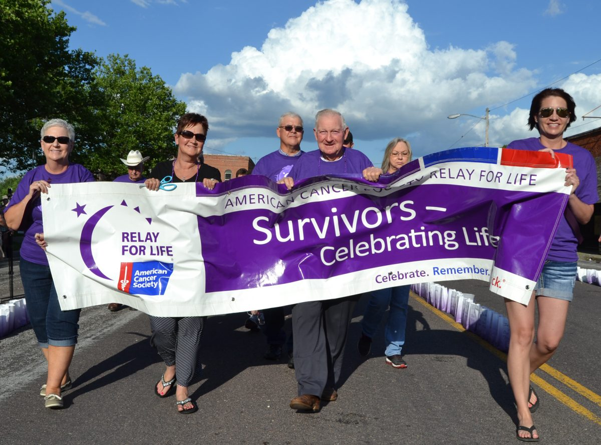 Survivor Lap-With bright skies ahead of them and clouds in their past, cancer survivors took the first lap at the Shelby County Relay for Life, held Saturday evening, June 3. A video of the opening ceremony and Survivor Lap can be seen below.