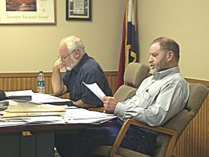 Kahoka Aldermen Jeff Wood and Larry Young review the wage ordinance.