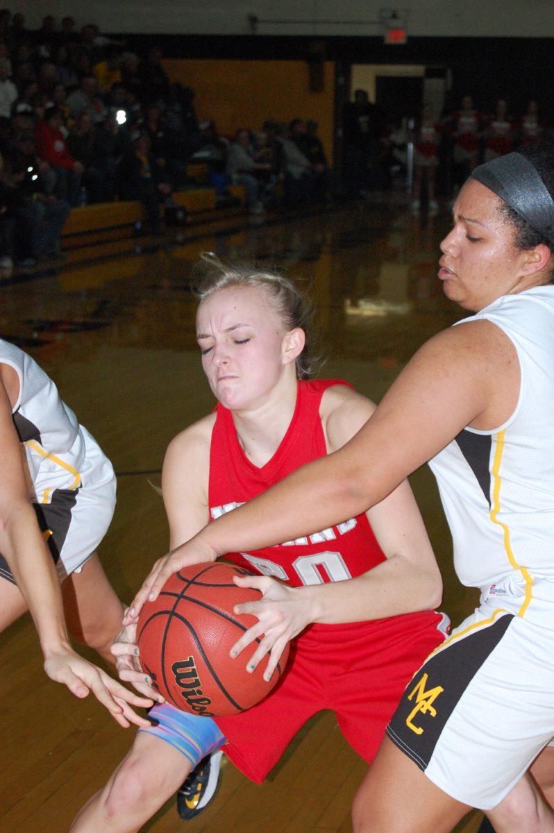 Carissa Bevans struggles for a shot against an aggressive Monroe City defense.