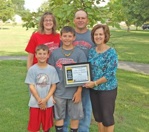 State Fair Farm Family--The ClarkCounty Extension Council has named the Jim and Coleena Day family as the recipient of the 2014 State Fair Farm Family Award. They are shown with their sons, Aaron and Austin, and Debby Whiston.