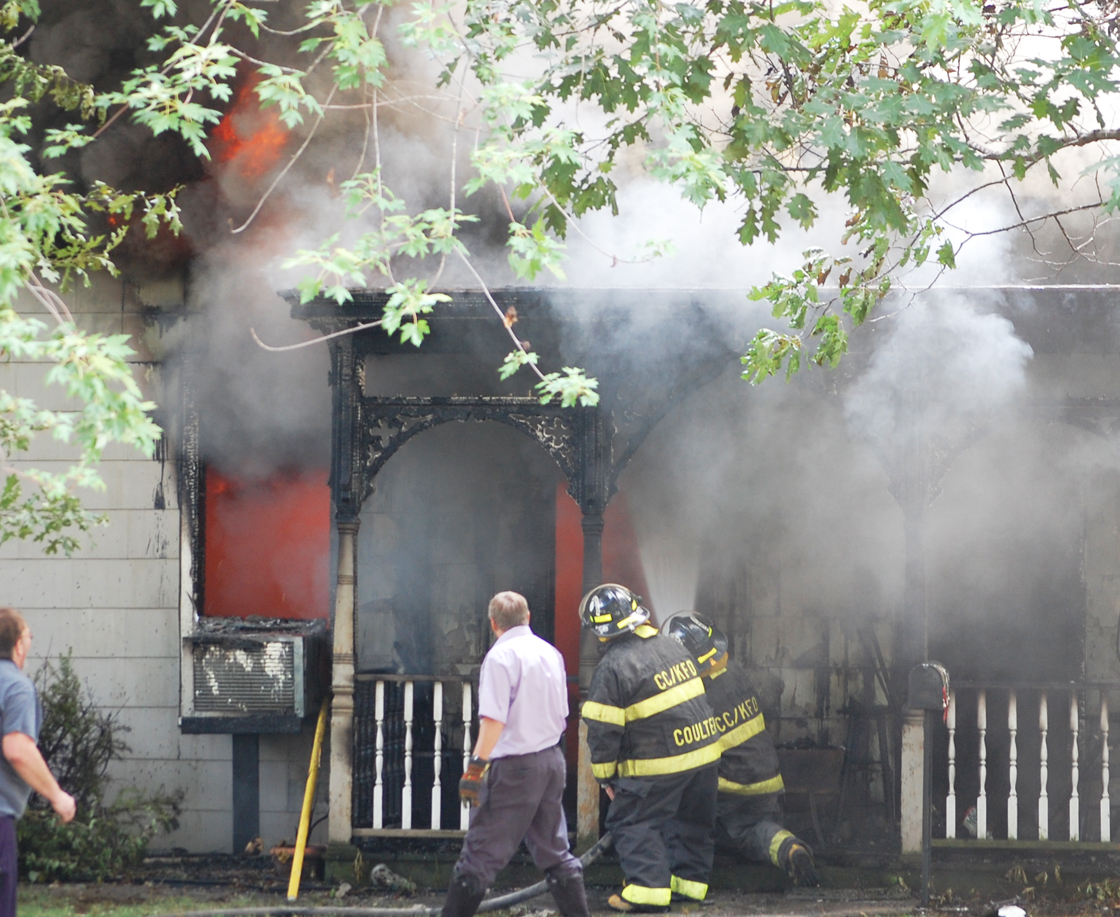 Kahoka firefighters battle a house fire on West Commercial Street on Friday afternoon.