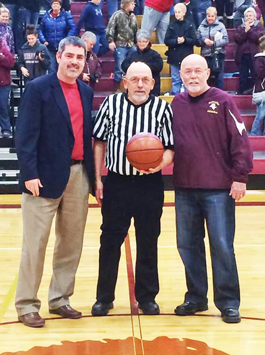 Rodney Gares is retiring after 45 years of officiating basketball. On Friday night, February 12, Gares called his last game, at Schuyler County. Kyle Wendy and Kenny Sparks presented Rodney with a ball for his 45 years of officiating High School Basketball