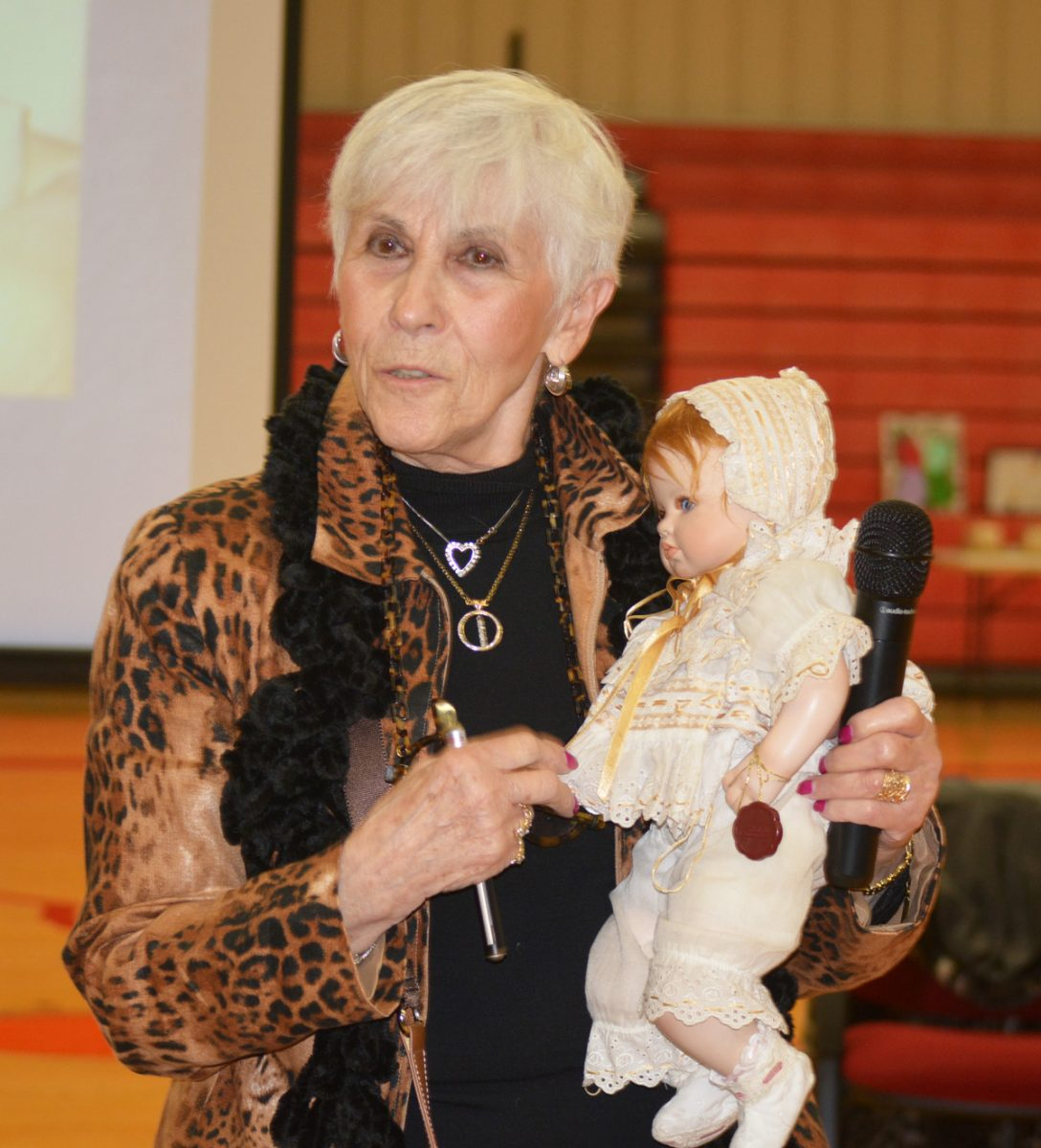 Rachel Goldman Miller, with her doll, as she spoke to Clark County R-1 students.