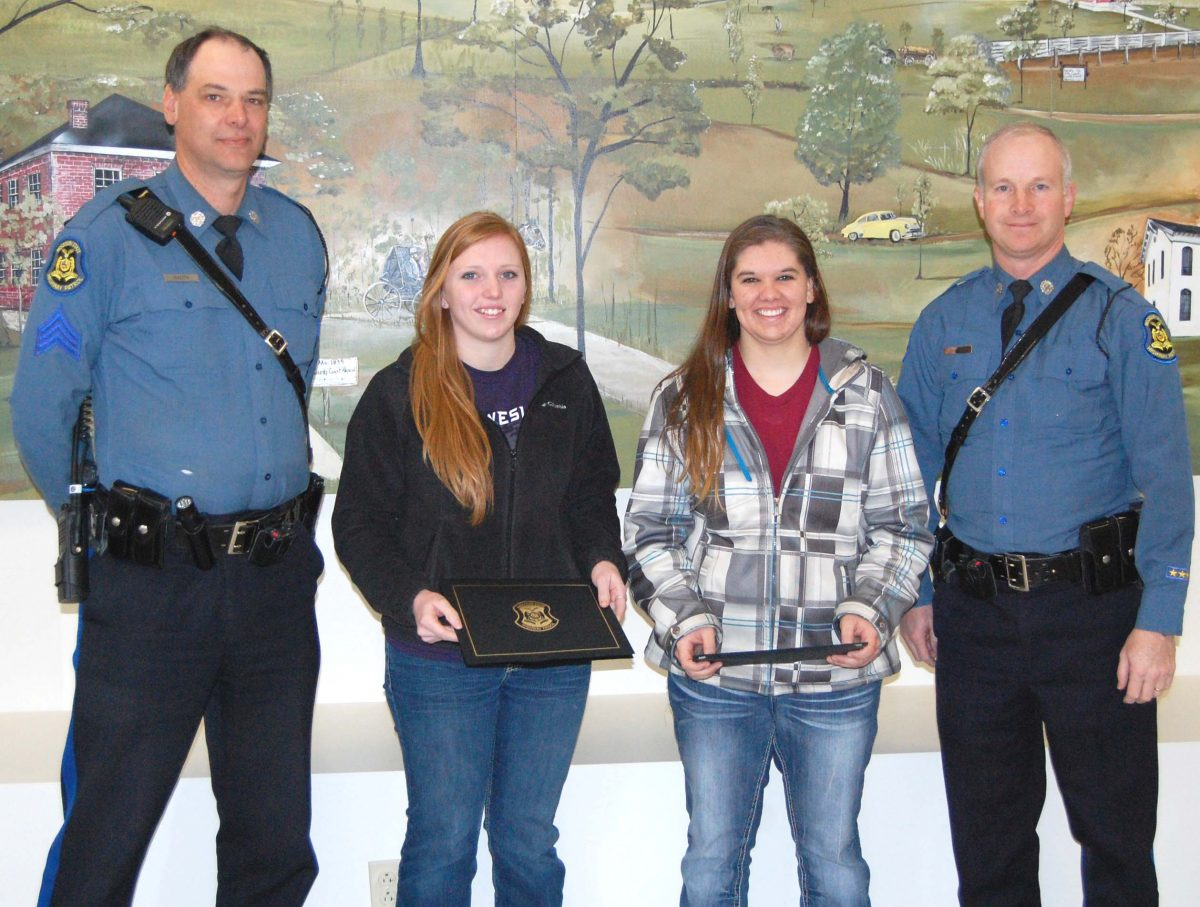 Heroes honored-Two southeast Iowa women were honored by the Missouri State Highway Patrol as HonoraryTroopers, for their actions last summer. Tiffany Barton of Montrose, and Jessica Beam of Donnellson reported a person rolling around in a bean field on June 30, 2013. An investigation by Trooper Brian Hillyer found an elderly woman suffering from dehydration and dementia. Barton and Beam's actions likely saved the woman's life. On Tuesday, March 5, they were presented with an Honoray Trooper award. Pictured are MSHP Sgt. Michael Kauth, Jessica Bea, Tiffany Barton and Trooper Brian Hillyer.