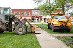 Clark County and City of Kahoka workers started removing sidewalks in Kahoka's City Park on Wednesday morning.