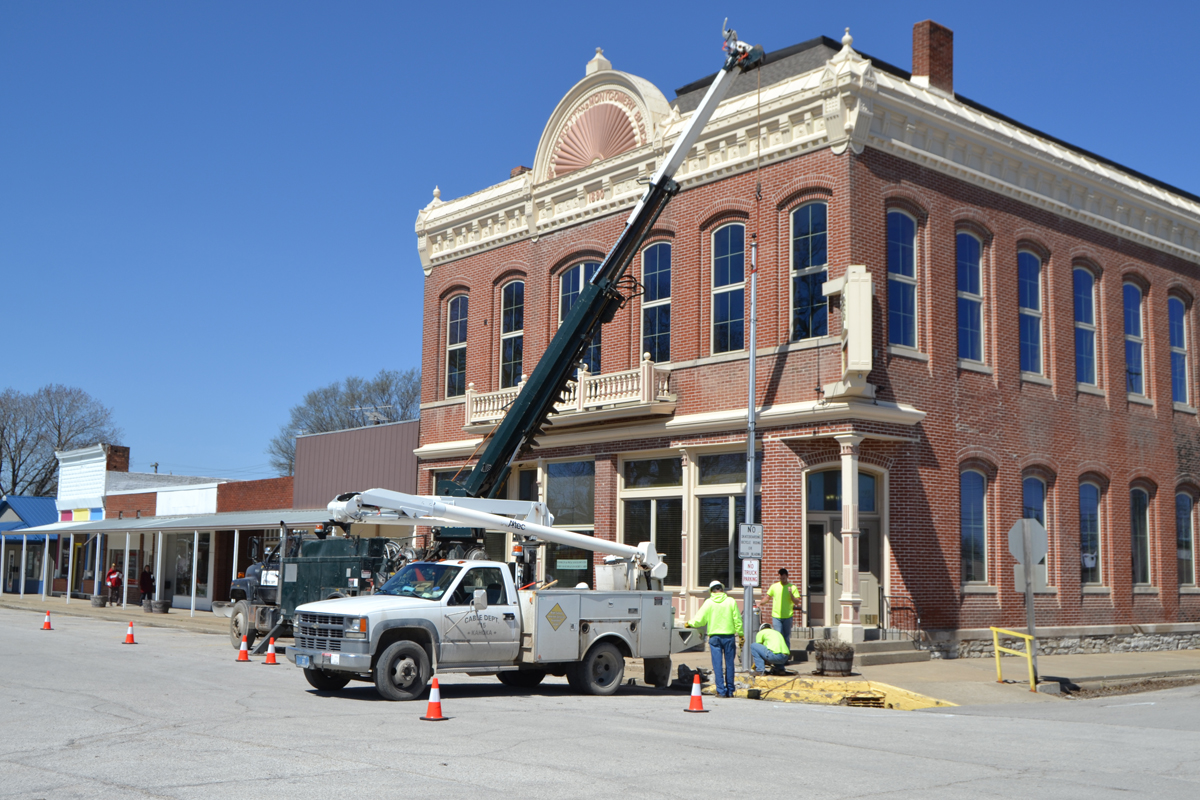 Kahoka city workers removed light poles on the north side of the square on Monday morning, as the first step in starting the downtown sidewalk replacement project. Sidewalks on the north and south sides of the square, as well as sections of adjacent sidewalk, will be replaced.