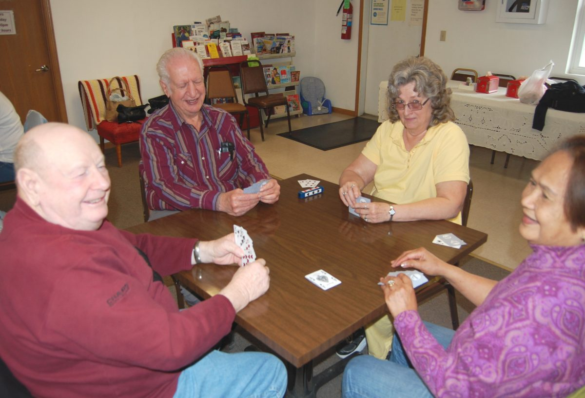 Enjoying Each Others' Company Over A Hand Of Cards--Mature adults from Clark County can gather at the Clark County Senior Center for a good meal, and enjoy each others company. Alan Cameron, Ed Bogguss, Barbie Bergman and Laura Cameron are among the euchre regulars. The Senior Center is supporting a five cent per $100 tax increase to support senior programs in Clark County.
