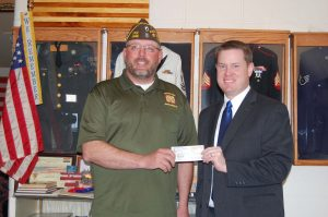 VFW Post 4342 Commander Rick Davis presents WGEM's Matt Schmidt with a check for $1200 to support the Great River Honor Flight.
